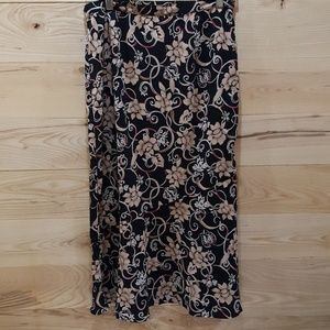 Beige and Black Floral Skirt with Red Accents